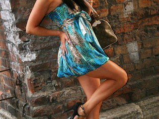 Young amateur model with nice legs poses..