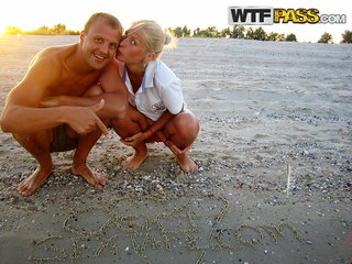 Alluring blonde girlfriend having fun on a beach