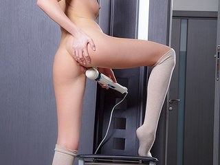 Teen babe pets her nude pussy with the vibrator